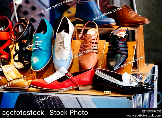 Close-up of retro shoes for sale in market stall