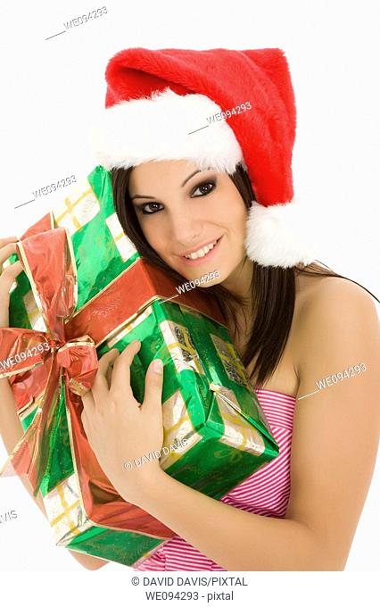 Beautiful Caucasain female holding gifts on white background
