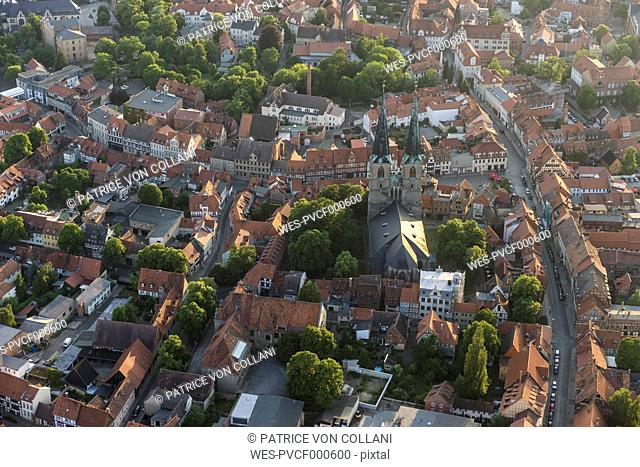 Germany, aerial view of Quedlinburg with St Nicholas' Church in the evening