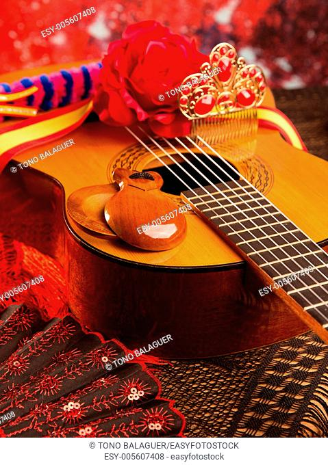 Classic spanish guitar with flamenco elements as comb fan and castanets