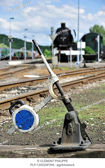 Steam train and track switch levers at the depot of the Chemin de Fer à Vapeur des Trois Vallées at Mariembourg, Belgium