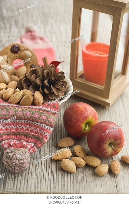Rustic Christmas decoration with red apples, nuts, lantern