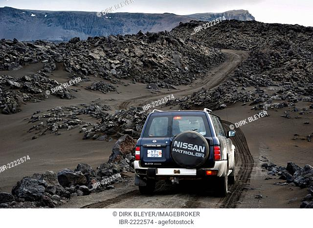 Jeep on the highland dirt road through the lava fields, highland, Iceland, Europe