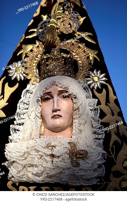 An image of the Virgin of Solitude decorates a banner on the procession of Palm Sunday during Easter Week in Prado del Rey, Sierra de Grazalema Natural Park