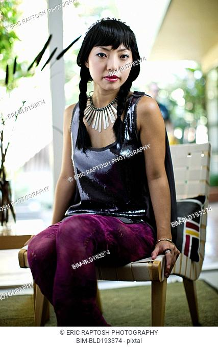 Asian woman in glamorous outfit