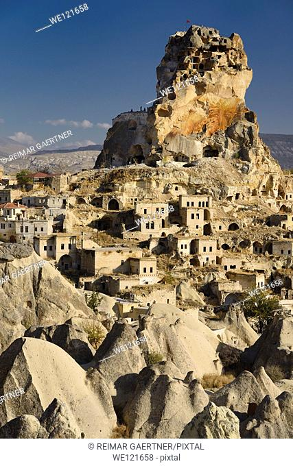 Fairy Chimneys Houses and Ortasihar Castle rock being repaired as a museum Cappadocia Turkey