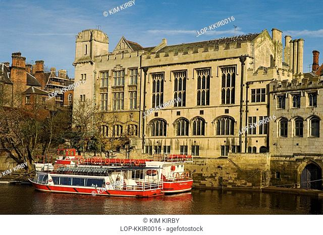 England, North Yorkshire, York, Pleasure boats moored beside the Guildhall on the River Ouse
