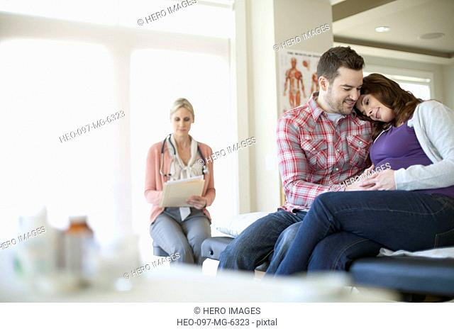 pregnant couple in medical office