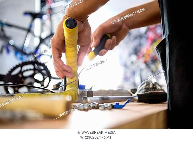 Close-up of worker repairing bicycles
