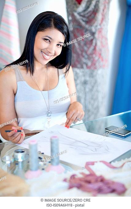 Clothing designer working at desk