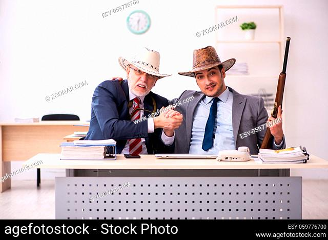 Two cowboy employees in funny concept