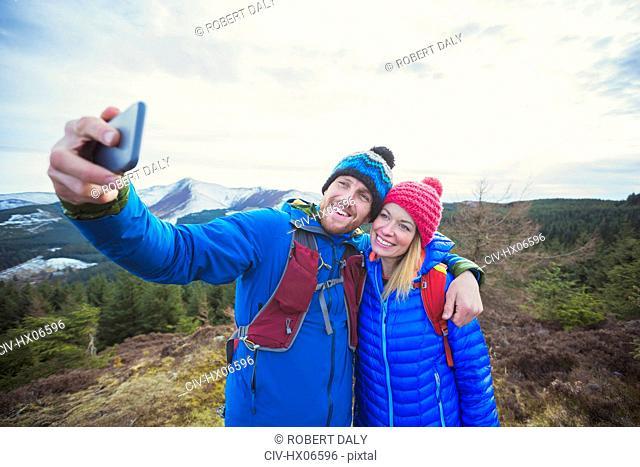 Couple taking selfie on mountaintop