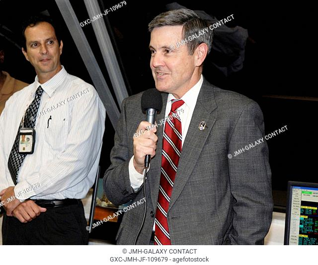 In the Firing Room of the Launch Control Center at NASA's Kennedy Space Center in Florida, Center Director Bob Cabana congratulates the launch team for the...