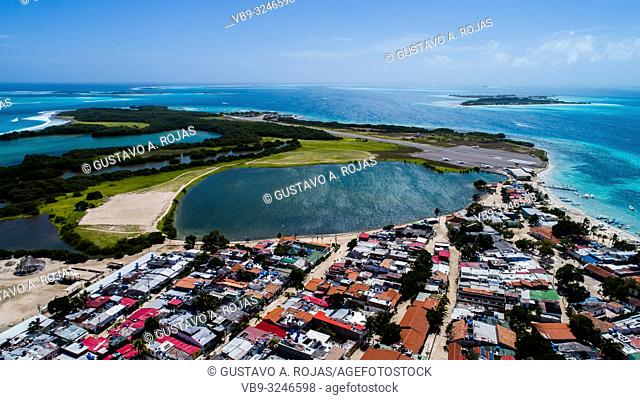 Los Roques small tropical Village with Lagoon Surrounded by crystal clear waters and beautiful beaches
