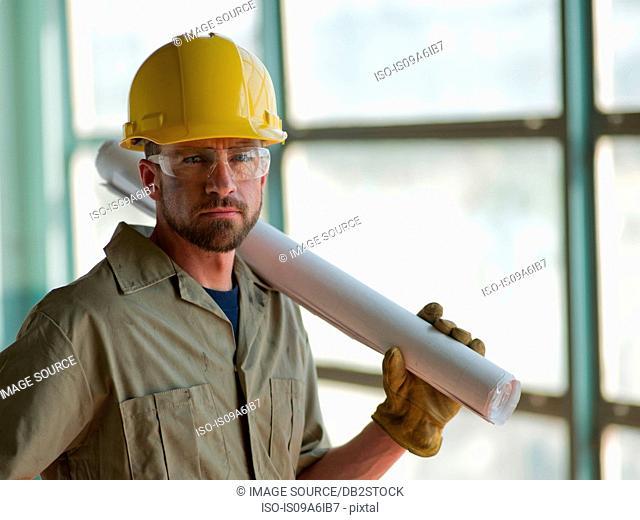 Engineer wearing hard hat on site