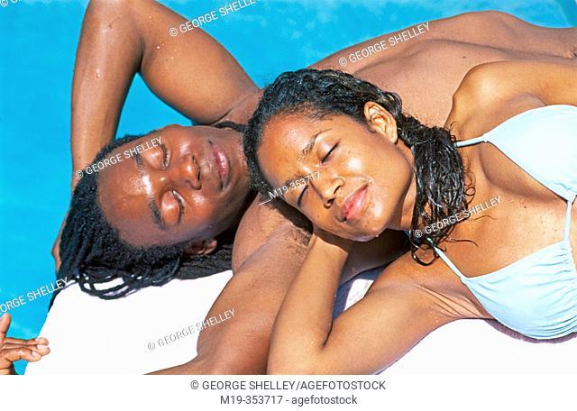 African American couple sun bathing