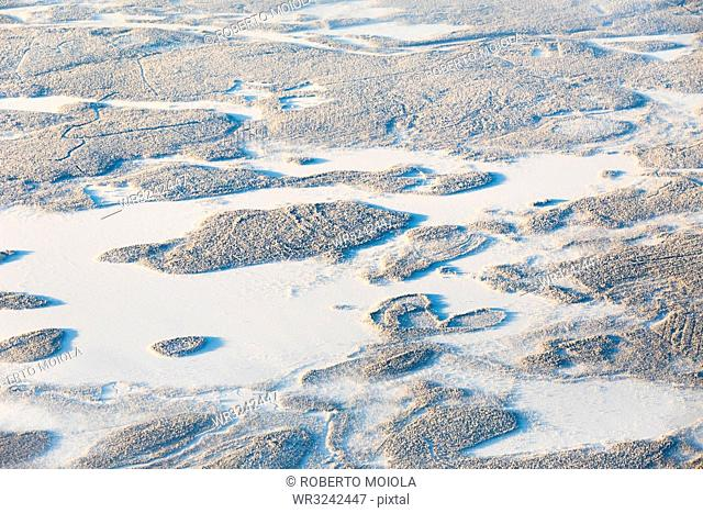 Aerial view of forest and hills in the frozen landscape, Levi, Kittila, Lapland, Finland, Europe