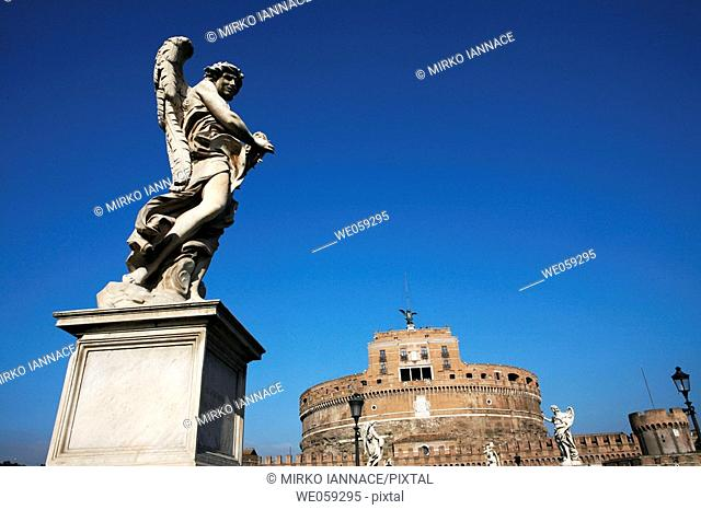 Sant'Angelo castle and bridge over Tiber river with one of the Bernini's angels at fore, Rome. Lazio, Italy