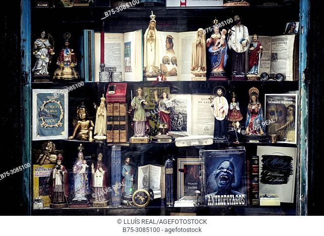 Shop window of a shop of objects, books and religious images. Lisbon, Portugal
