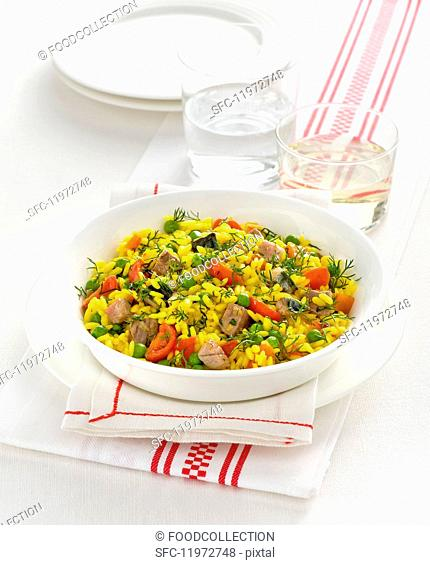 Risotto with saffron, meat and vegetables