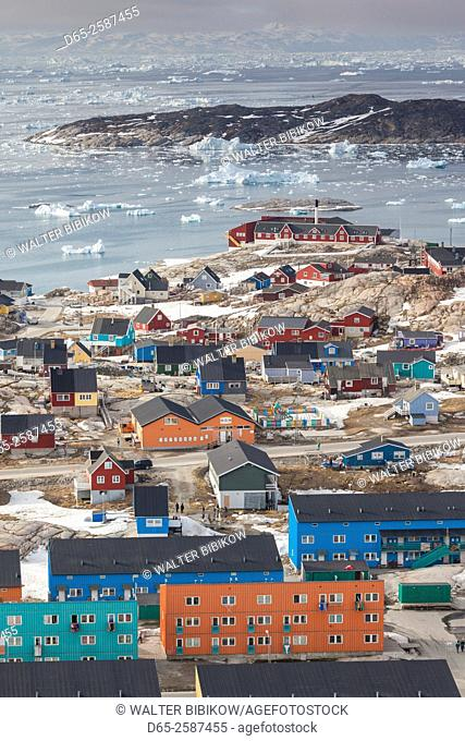 Greenland, Disko Bay, Ilulissat, elevated town view with floating ice