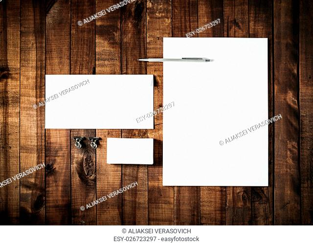 Blank stationery set on vintage wooden table background. ID template. Mockup for branding identity for designers. Blank letterhead, business card