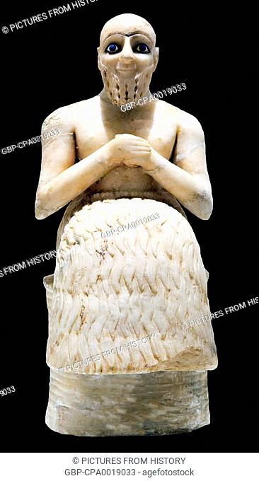 Syria: Statue of the administrator Ebih II in gypsum, lapis lazuli and shell. From the Temple of Ishtar, Mari, c. 2400 BCE