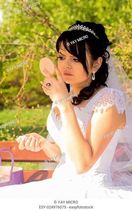 young bride is doing makeup