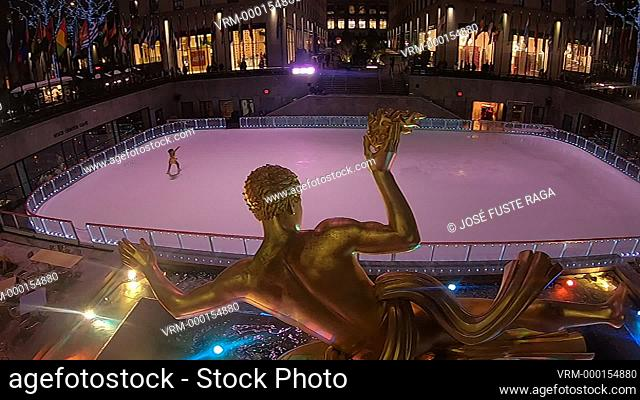 Skating rink and Statue of Prometheus in the lower plaza of the Rockefeller Center, Manhattan, New York, New York State, United States of America