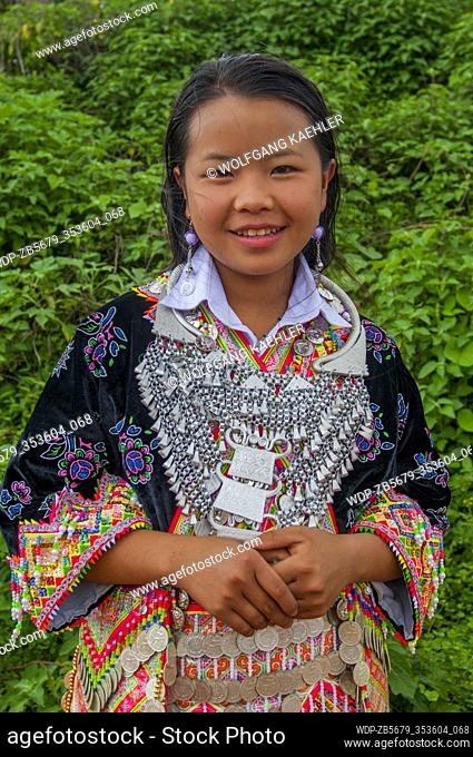 A Hmong teenage girl in a traditional festive dress in a village near Phonsavan (originally known as Muang Phouan), the capital of Xiangkhouang province in Laos