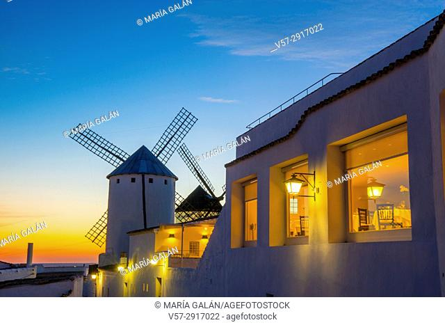 Windmill and restaurant at nightfall. Campo de Criptana, Ciudad Real province, Castilla La Mancha, Spain