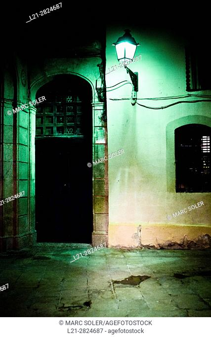 Entrance of a house and streetlight lit at night. Barcelona, Catalonia, Spain
