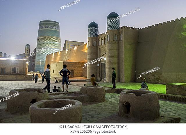 Kalta Minor minaret and Kuhna Ark, in Execution Square, Khiva, Uzbekistan