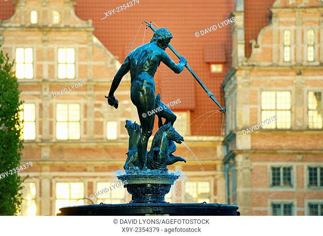 Gdansk Poland. The Old Town. The Neptune Fountain, erected 1633, with the ornate façade of the Green Gate behind