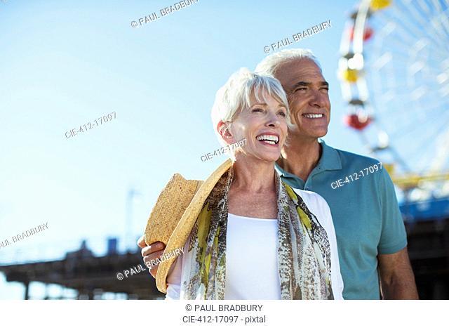 Happy senior couple at amusement park