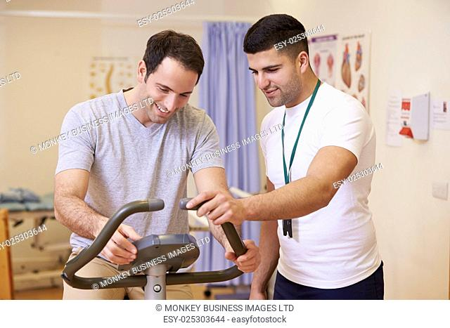 Patient Having Physiotherapy On Exercise Bike In Hospital