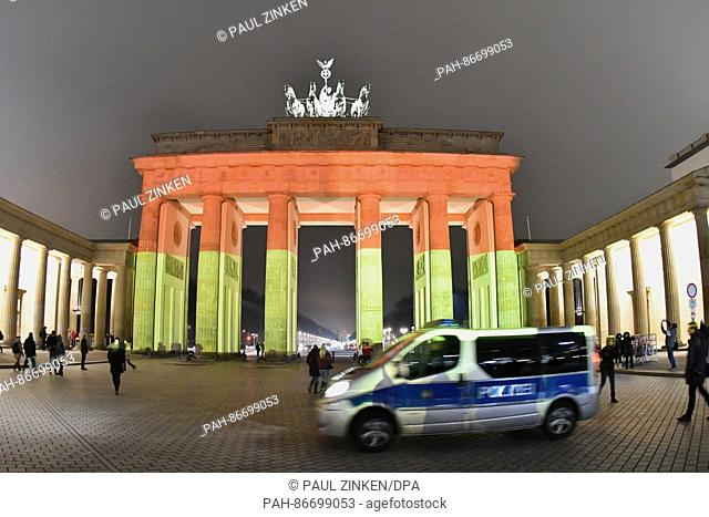 The Brandenburg Gate is illuminated in the colours of the German flag in Berlin, Germany, 20 December 2016 to commemorate the victims of a suspected terror...