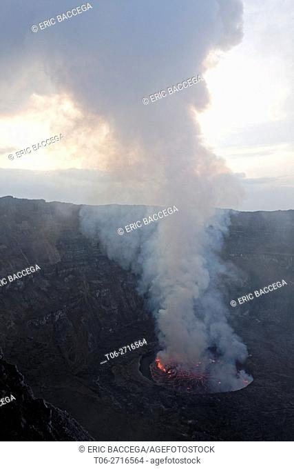Steam rising from active lava lake in the crater of Nyiragongo Volcano, Virunga National Park, North Kivu Province, Democratic Republic of Congo, Africa