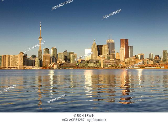 The City of Toronto reflected in Lake Ontario just after dawn as seen from the Polson Pier, Toronto, Ontario