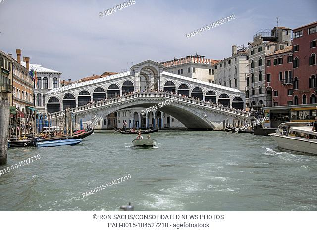 High resolution view of the Rialto Bridge from a water taxi in the middle of the Canal Grande (Grande Canal) in Venice, Italy during the noon hour on Sunday