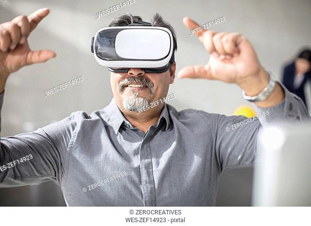 Man wearing VR glasses in office