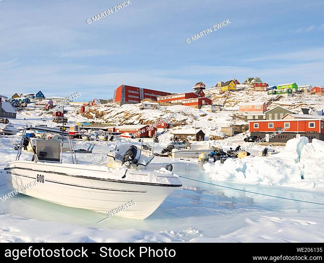The frozen harbour of Uummannaq during winter in northern Westgreenland beyond the arctic circle. North America, Greenland, Danish territory
