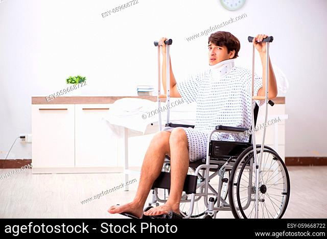 Young handsome man in wheelchair at the hospital