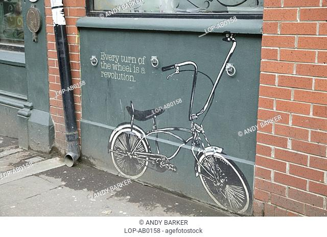 Northern Ireland, Belfast, Belfast, A painting of a low rider bike on a Belfast street wall