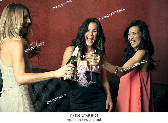 Women toasting with champagne in nightclub