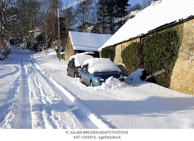 cars snowed in down a country lane, Oxfordshire  Impassable road