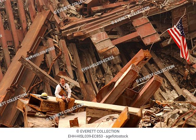 Solo firefighter sitting on a beam in the wreckage of the World Trade Center, Sept. 28, 2001. New York City, after September 11, 2001 terrorist attacks
