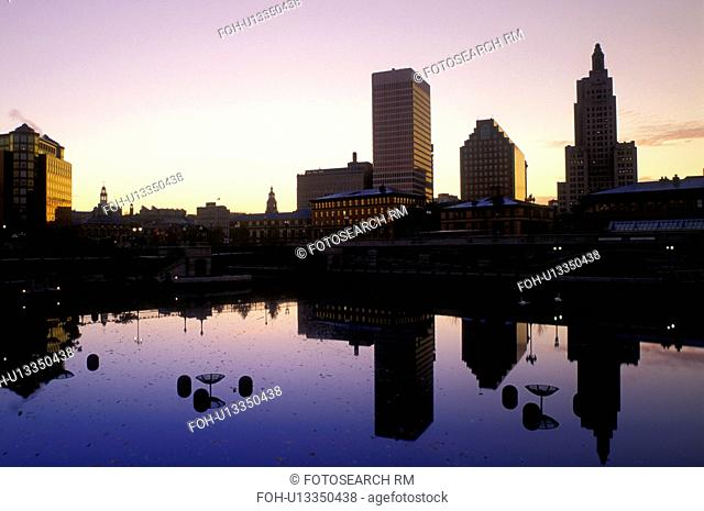 Providence, Rhode Island, RI, Buildings reflect in the calm water of the Woonasquatucket River at Waterplace Park in downtown Providence at sunrise