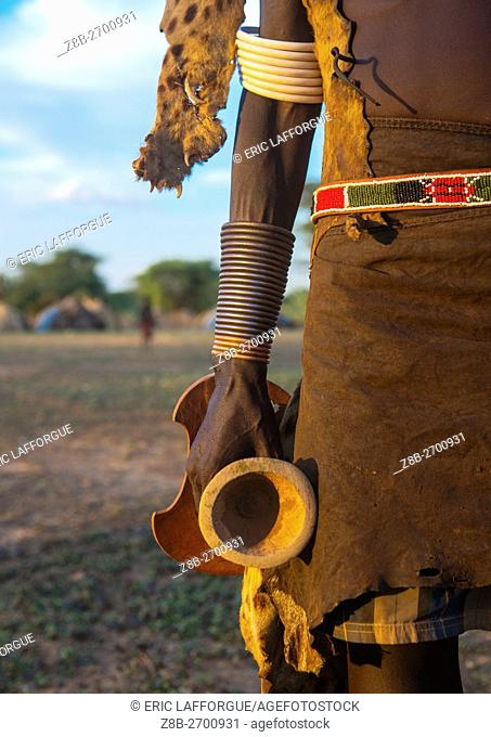 Ethiopia, Omo Valley, Omorate, dassanech man with his wooden pillow during dimi ceremony to celebrate circumcision of the teenagers