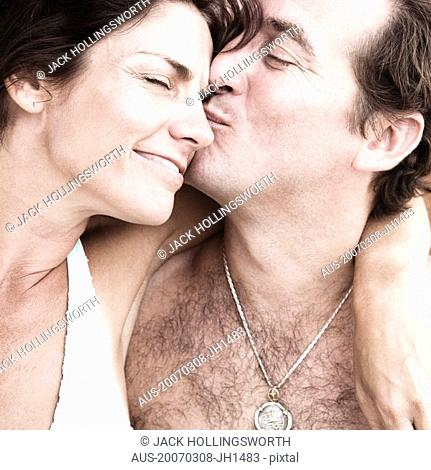 Close-up of a mid adult man kissing a mid adult woman